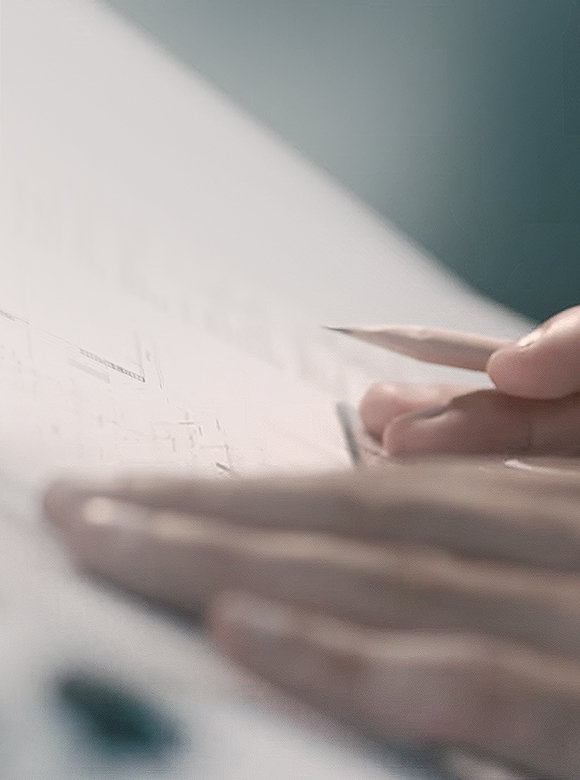 A man is writing something with pencil