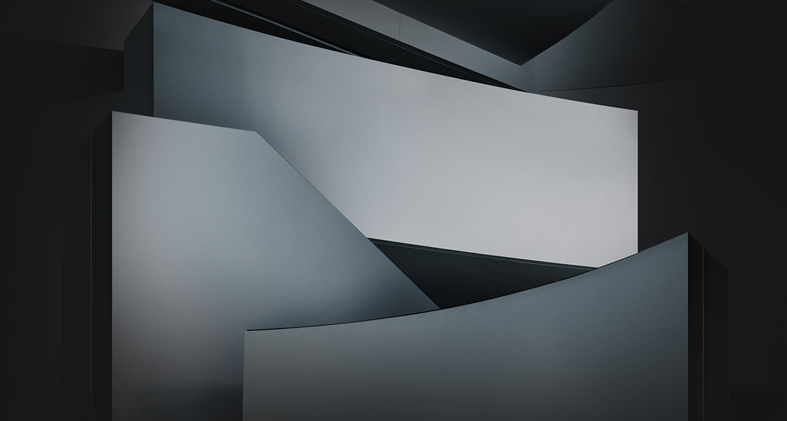 Conceptual image of white geometrical shapes in a black background with shade
