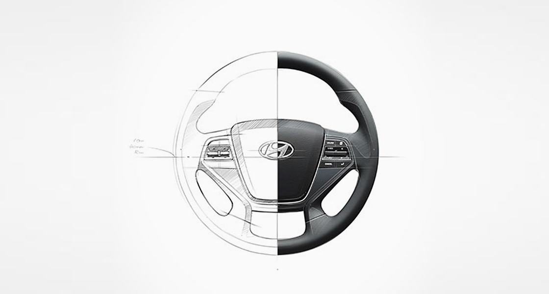 Image of a steering wheel half drawn on the left and half photographed on the right