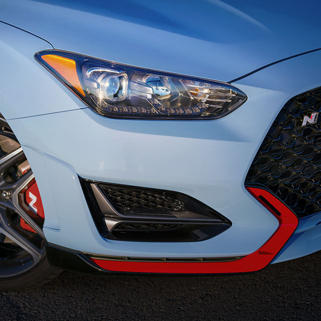 closer view of right side front view of blue veloster n