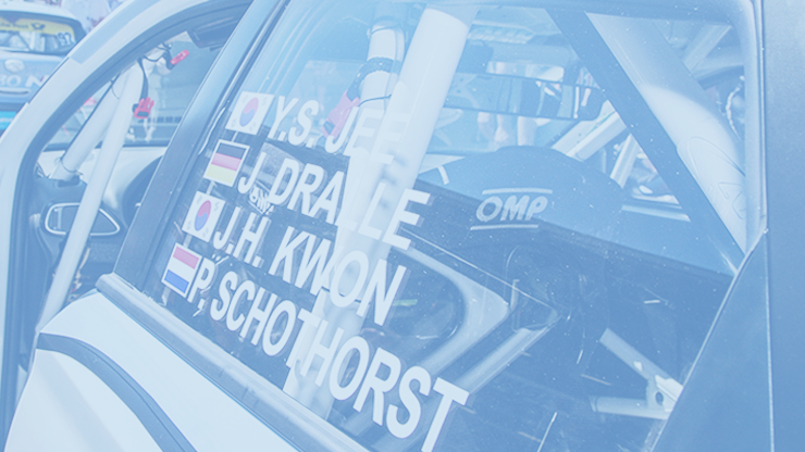 the names and nationalities of drivers on the racing car window
