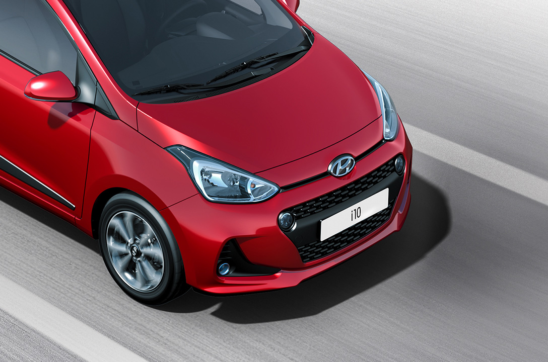 Cropped view of front part of red i10