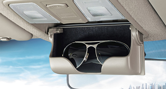 Car sunglasses storage box opened at the center of the front roof area