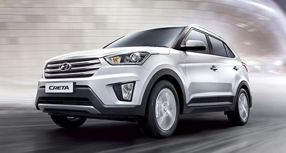 Side-front view of white Creta driving