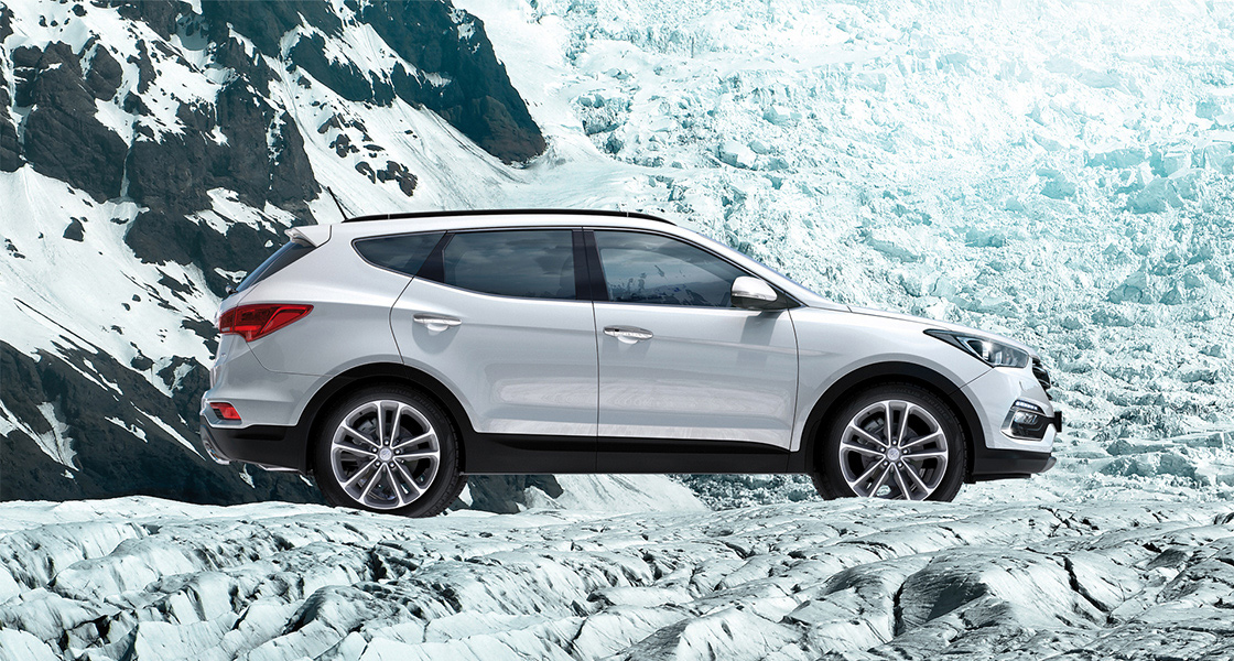 Side view of white Santa Fe on the snowy mountain