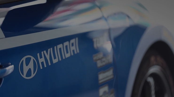 side view of blue hyundai car