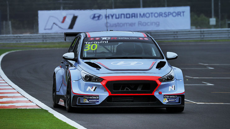 front view of i30 N TCR is driving on racing track