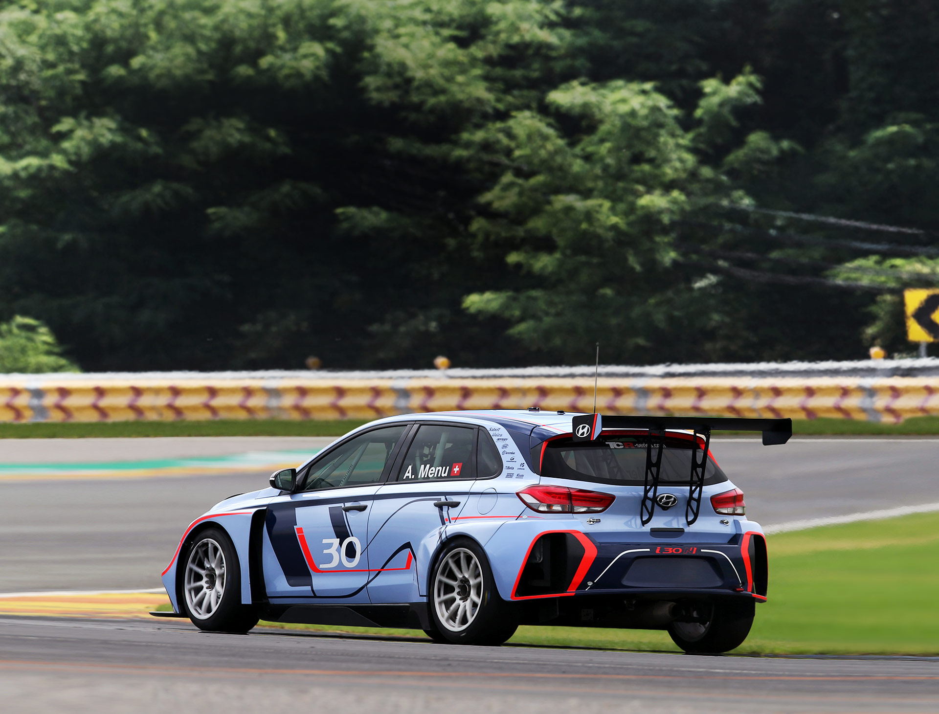 left side rear view of i30 N TCR is running on racing track