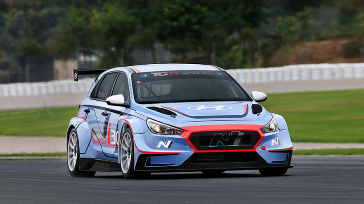 right side front view of i30 N TCR is running on racing track