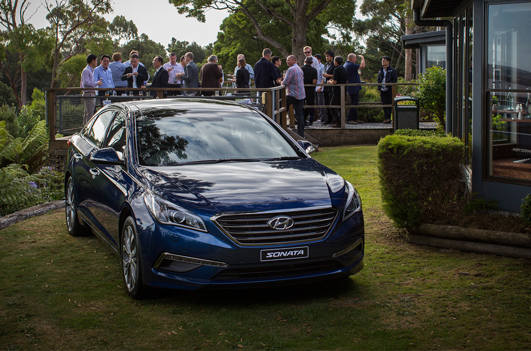 Front view of blue Sonata on the lawn